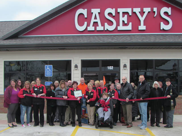Mary Jones | The Daily Advocate A ribbon cutting celebrating the opening for Casey's General Store in Union City, Indiana. Several members of the community, as well as Union City Chamber of Commerce President Susan Linder were in attendance.