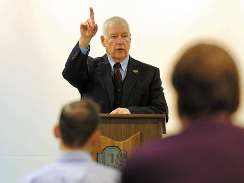 Ohio High School Athletic Association Director Dr. Dan Ross motions while addressing a media conference in Columbus on Tuesday. Ross will step down in September after working as the association's commissioner for 14 years.