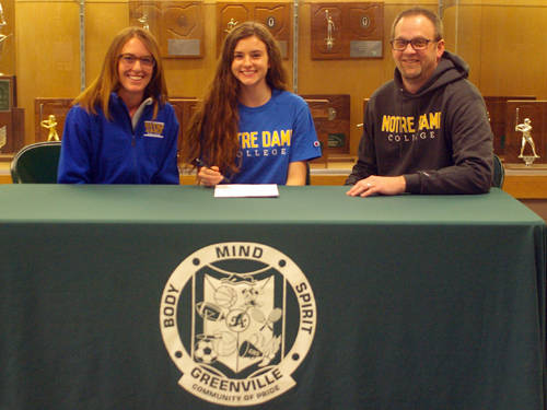 Greenville senior Grace Coakley committed to run for the Notre Dame College cross country and track and field teams on Wednesday. She is pictured with her mother Stephanie Lind and and stepfather Scott Lind. Not pictured is her father, Joe Coakley.