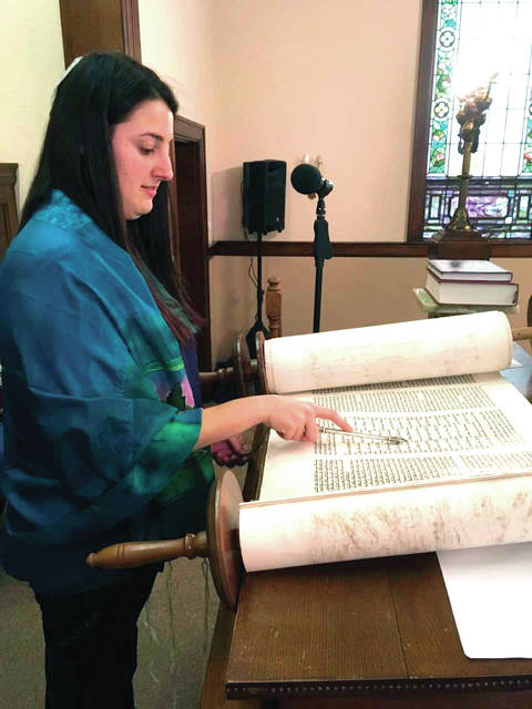 Courtesy photo Rabbinic Intern Taylor Poslosky pointing out the structure of the Song of Songs from the Torah at a service earlier this year. Taylor will lead a class on Hebrew and Aramaic in the Torah in a program on Saturday, April 21, from 1 to 2:30 p.m.