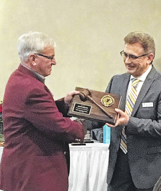 Outgoing Darke County YMCA board president John Keller was recognized for his years of service by CEO of the Darke County YMCA Sam Casalano. John Swallow takes over as the new president. Keller will continue to serve as past president.
