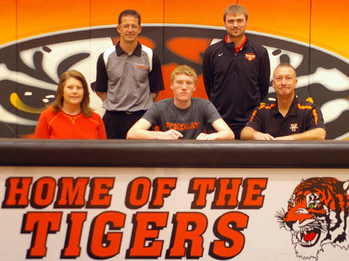 Versailles senior Josh Steinbrunner committed to the University of Findlay track and field team on Thursday morning. Pictured are (front row, l-r) mother Janet Steinbrunner, Josh Steinbrunner, father Doug Steinbrunner, (back row, l-r) Versailles track and field coach Mike Goubeaux and Versailles Athletics Director Doug Giere.
