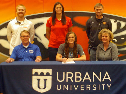 Versailles senior Kami McEldowney committed to the Urbana University women's basketball team on Friday morning. Pictured are (front row, l-r) father Roger McEldowney, Kami McEldowney, mother Holly McEldowney, (back row, l-r) Versailles girls basketball assistant coach Brian Shappie, Versailles girls basketball head coach Jacki Stonebraker and Versailles Athletics Director Doug Giere.