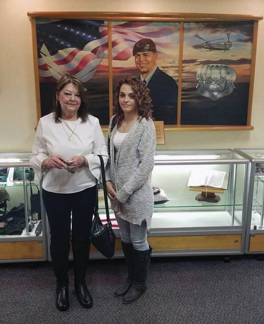 "Courtesy photo Local military mom Sheila McDaniel and her granddaughter Ashley McDaniel recently traveled to Okinawa, Japan to see a training center that was named after her fallen son Air Force Master Sgt. William ""Bub"" L. McDaniel II."