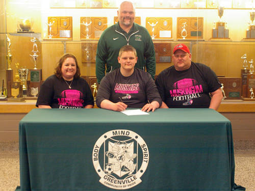Greenville senior Tanner Swisshelm committed to the Muskingum University football team on Wednesday. Pictured are (front row, l-r) mother Mandy Swisshelm, Tanner Swisshelm, father Dave Swisshelm and (back row) Greenville football coach Aaron Shaffer.