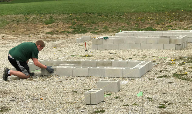A volunteer builds raised beds during the parks' Earth Day event.