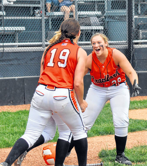 Bradford's Aspen Weldy and Skipp Miller (19) react after Bradford scored the winning run in the eighth inning Sunday in a Division IV district championship game.