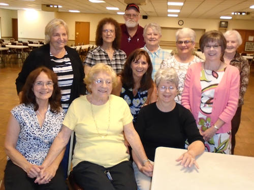 Delores Beisner retired from the Cancer Association of Darke County Board of Directors after 22 years of service. Pictured are (front row, l-r) Executive Director Christine Lynn, Delores Beisner, Becky Saylor, (second row, l-r) Barbara Fee, Susan Fowble, Secretary Sherry Marten, (third row, l-r) Treasurer Trudy Eastland, Sharon Kerns, Carolyn Fletcher, President Kay Curry and (back row) Vice President Duane Edwards.