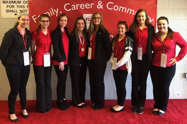 The Versailles FCCLA chapter went to the annual FCCLA state conference. Pictured (l-r) are Alyssa Dieringer, Allison Reed, Madelyn Vogel, Jenna Mangen, Danielle Nerderman, Skyler Clune, Savannah Toner and Morgan Barlage