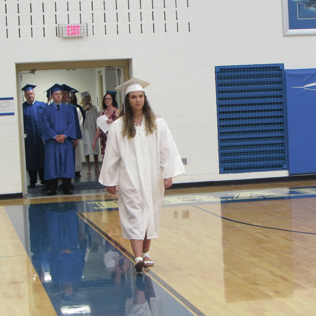 Franklin Monroe students celebrate its graduation day Saturday, amid the rain and storms.
