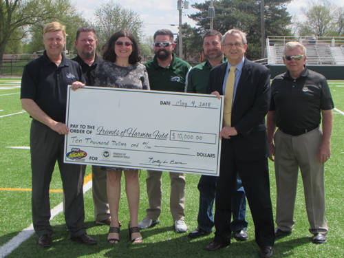 Friends of Harmon Field received a donation from Mercer Savings Bank for $10,000 to help fund its project for the Greenville athletics facilities.