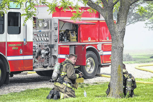 Union City firefighters take a breather after battling a residential fire at the 9900 block of Detling Road, Ansonia. First responders from multiple jurisdictions arrived to fight the blaze.