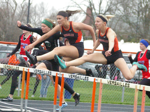 Versailles' Jaden Prenger and Dana Rose clear a hurdle during the Stillwater Valley Invitational track and field meet on April 24 in Versailles.