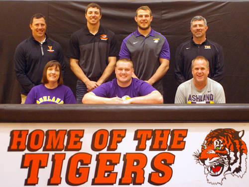 Versailles senior Jeffrey Ware committed on Monday morning to wrestle at Ashland University. Pictured are (front row, l-r) mother Kim Ware, Jeffrey Ware, father Rick Ware, (back row, l-r) Versailles wrestling assistant coach Jerry Bey, Versailles wrestling assistant coach Tyler Bey, Versailles wrestling assistant coach Joe Brandt and Versailles wrestling head coach A.J. Bey.