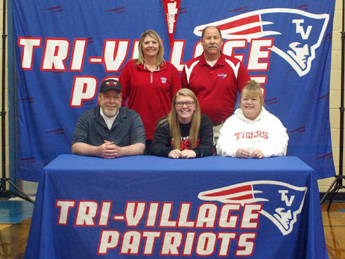 Tri-Village senior Kathryn Combs committed to the Wittenberg University track and field team on Monday afternoon. Pictured are (front row, l-r) father Erik Veitch, Kathryn Combs, mother Madonna Veitch, and (back row, l-r) Tri-Village track and field coaches Christy Sarver and Scott Warren.