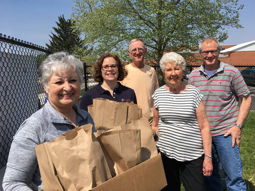 Lambda Chi Omega Sorority, Gamma Epsilon Chapter, donated more than 400 lunches for the Darke County Special Olympics. Pictured (l-r) are sorority members and volunteers Charlotte Wright, Becky Luce, Glen Rehmert, Linda Rehmert and George Luce.