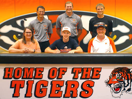 Versailles senior Luke Shellhaas committed to the Ohio Northern University track and field team on Tuesday. Pictured are (front row, l-r) mother Beth Shellhaas, Luke Shellhaas, father Dave Shellhaas, (back row, l-r) Versailles track and field coach Mike Goubeaux, Versailles pole vault coach Adam Schwartz and Versailles Athletics Director Doug Giere.