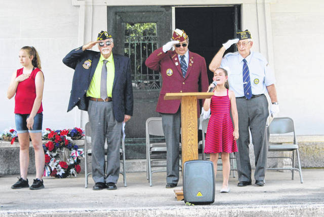 "Mora Menzie of Arcanum sang ""The Star-Spangled Banner"" during Greenville's Memorial Day ceremonies. She was one of many participants who gathered Monday to honor America's veterans who died in the service of their country."