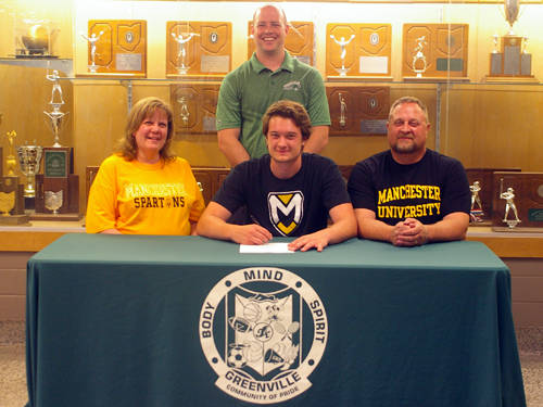 Greenville senior Noah Vanhorn committed to the Manchester University men's basketball and track and field teams on Thursday. Pictured are (front row, l-r) mother Stacy Vanhorn, Noah Vanhorn, father Mike Vanhorn and (back row) Greenville boys basketball coach Kyle Joseph.