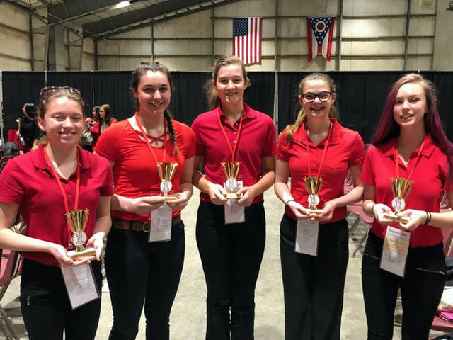 Versailles FCCLA members (l-r) Skyler Clune, Alyssa Dieringer, Savannah Toner, Allison Reed, and Madelyn Vogel received their Power of One awards.