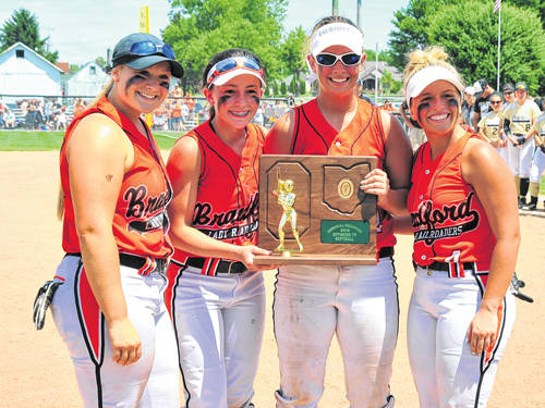 Bradford seniors Aspen Weldy Chelsea Gill, Bailey Wysong and Hannah Fout pose for photos with the Division IV regional championship trophy following a 12-1 run rule win over Parkway on Saturday at Greenville.