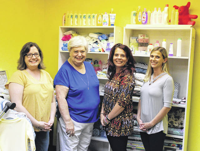 Jeannette Shuff (second from right) is the new director of the Darke County Pregnancy Help Center. She is joined by (from left) Mentor Consultant Colleen Harper, former Director Lois Monroe and SRA Presenter Jessica Barga.