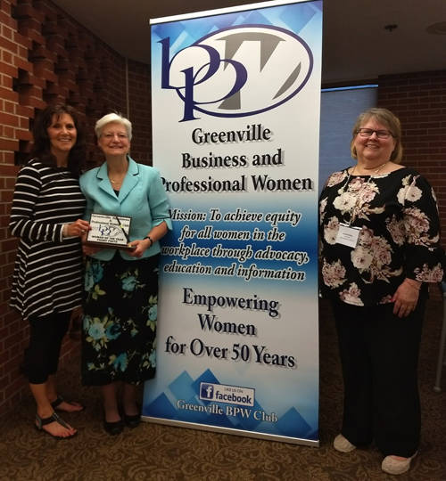 Greenville Business and Professional Women award the BPW Woman of the Year award to Peggy Foutz. Pictured are BPW Secretary Susan Fowble, Woman of the Year winner Peggy Foutz and BPW President Brenda Miller.