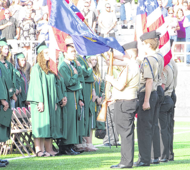 Color Guard members present the flag to the Class of 2018 during Saturday's graduation ceremony in Greenville.