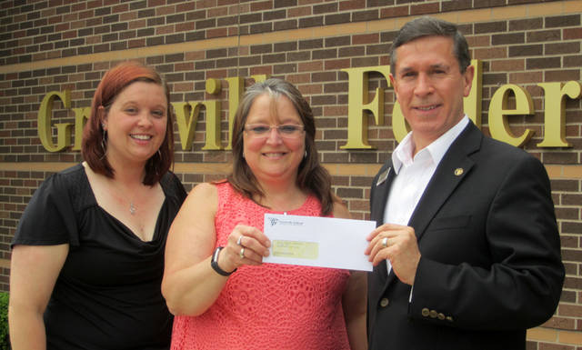 Greenville Federal President and CEO Jeff D. Kniese presented the Annie Oakley Festival Committee with a sponsorship check for the 2018 festival.