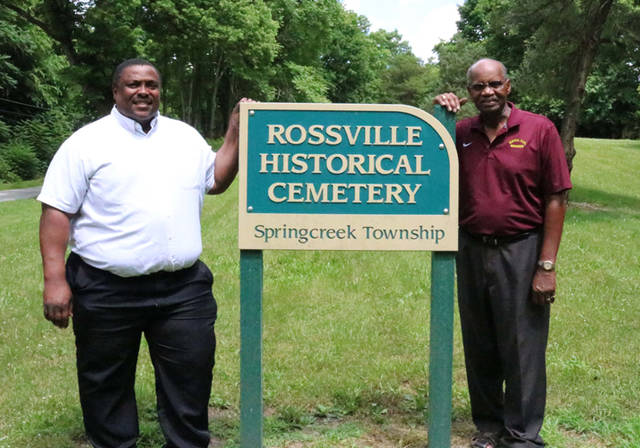 Kris Lee (right) and Larry Hamilton (left) are pictured at the African Jackson Cemetery in Rossville.