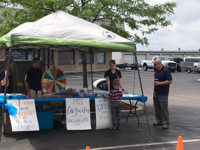 The Versailles FFA chapter had a free activities tent, including a spin the wheel with ag facts and an ag info bracelet, open to all customers who came to Culvers to support them on May 19. FFA members (l-r) Jaylynne Trissell, Greg Dirksen and Kennedy Hughes helped run the tent.