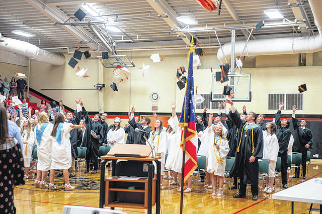 Ansonia graduates toss their hats in the air to celebrate successful completion of high school. The Class of 2018 saw 53 students receive diplomas May 27.