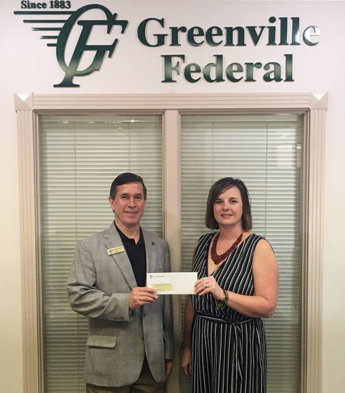 Jeff D. Kniese, president and CEO of Greenville Federal, presents a check to Andrea Jordan, Darke County Center for the Arts executive director.