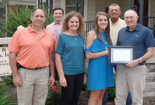 Danielle Winner of Versailles earned a $1,000 scholarship from Mote & Associates. Pictured are (front row) Dale Winner, Cheryl Winner, Danielle Winner, Michael Henderson, (back row) Jerry McClannan and Louis Bergman.