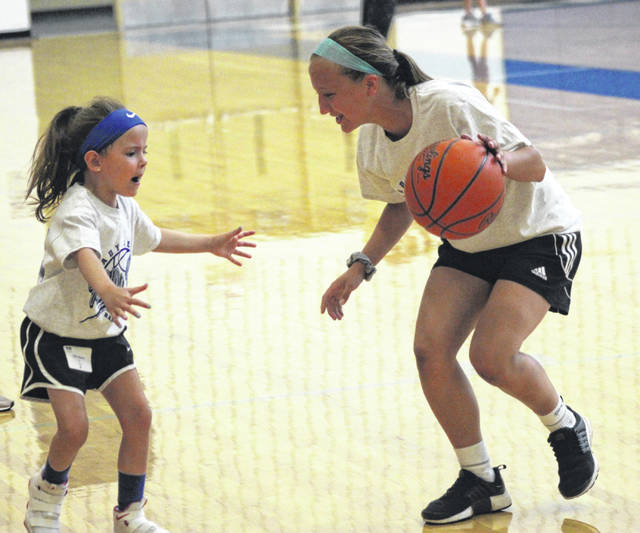 Junior-to-be Chloe Brumbaugh (right) works on some basic defense with one of the younger campers on Wednesday, the last day of the Franklin-Monroe girls basketball youth camp. There were more than 30 participants in the camp each of the three days it was held.