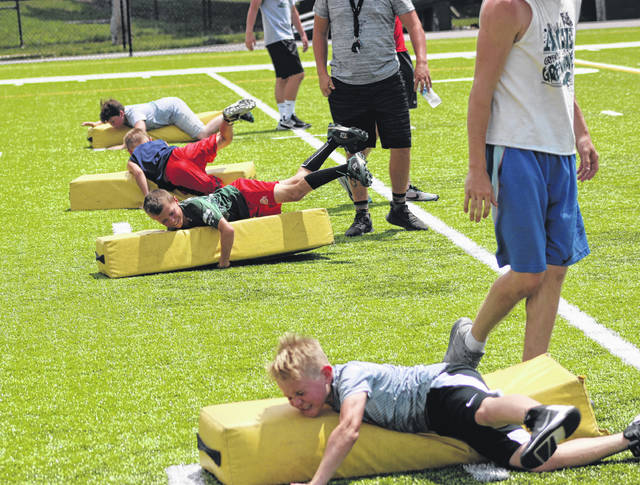 More than 30 Greenville Youth Football Camp participants learned the proper techniques for tackling during drills on Tuesday at Greenville High School. The three-day camp, which concludes today, is for students entering grades 2-6 in the 2018-19 school year.