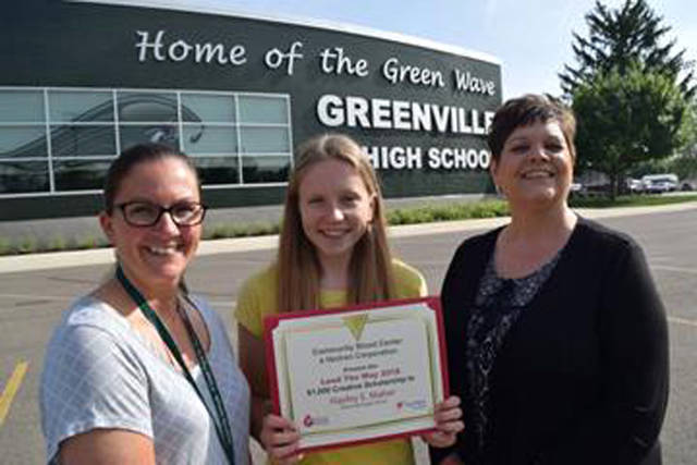 Greenville's Hayley Maher earned the Community Blood Center/Vectren Lead The Way Creative Scholarship. Pictured (l-r) are Greenville Senior High School Medical Tech Prep teacher and blood drive coordinator Amanda Koenig, Maher and CBC Account Representative Dana Puterbaugh.