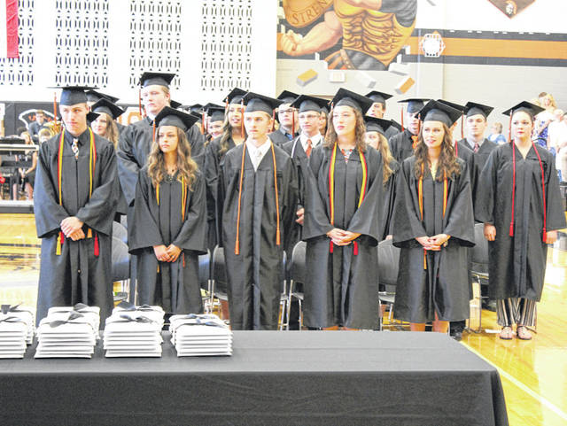 Arcanum High School seniors stand at Arcanum's commencement exercises held Sunday. The day saw 90 diplomas awarded to the Class of 2018.