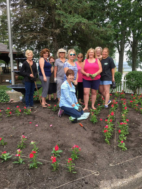 Members of the Ladybug Garden Club planted the entrance gardens to the Darke County Fairgrounds. Pictured (back row, l-r) are members Shirley Linder (committee member), Angela Beumer, Cathy Detrick, Becky Collins (committee member), Carol Baughman, Sherri Jones, Kim Cromwell, Irma Heiser, Lisa Marcum and (kneeling) Cindy McCallister. Not shown were Sherry Ward and Charlene Thornhill.