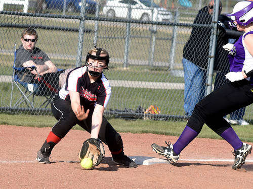 Mississinawa Valley's Paxton Scholl fields a ball during a softball game against Fort Recovery on April 13 in Union City.