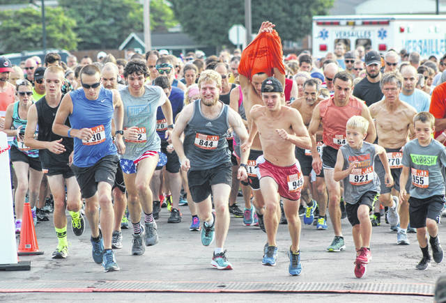 Runners take off from the start line on Saturday in the annual 5k race at the Versailles Poultry Days.