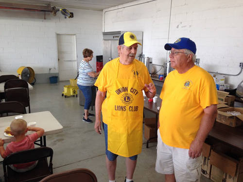 Union City Lions members Hoddy Speight (left) and Gary Miller (right) oversee the activity on Saturday at the 68th annual Randolph County Airport Fly-In.