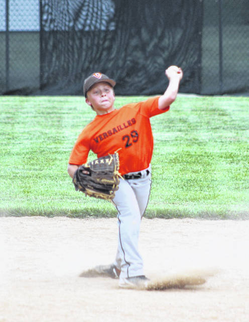 Ross Francis makes a throw to first base from his shortstop position in the bottom of the sixth inning of the Versailles 11U team's 7-5 win over Marion Local on Saturday during the Craig Stammen Baseball Tournament in Versailles.