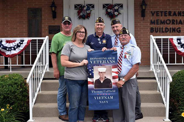 Versailles will recognize more than 200 veterans with banners in the village. Pictured are (front row) Kim Custenborder of Prosperity Promotions; Tim Wagner, commander of VFW Post 3849, Versailles; (back row) Roger Henry, commander of American Legion Post 435, Versailles; Richard Coffield, chairman of the banners; and Dave Miller, advisor.