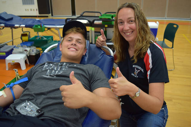 Mississinawa Valley High School FFA member Elijah Livingston and Mississinawa Valley FFA advisor Gwen Bergman are pictured at the ninth annual FFA Grudge Match Blood Drive in Ansonia.