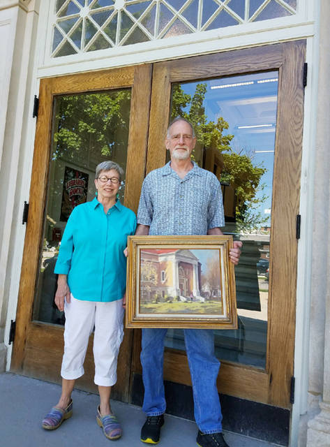 Dede and Bill Wissman lent a painting by local artist Bob Brubaker to the Greenville Public Library for the summer.