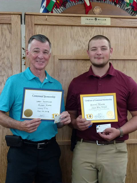 Zach Myers (right) was inducted as the newest member of the Union City Lions Club. He is pictured with his sponsor, Larry Amspaugh.