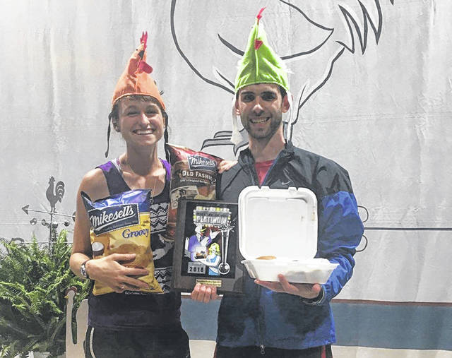 Ryan Stoneberger of Columbus, with his fiance Alora Rieff, was the purchaser of the Versailles Poultry Days' 1 millionth chicken dinner. He was awarded a number of prizes, including a trip to Las Vegas.