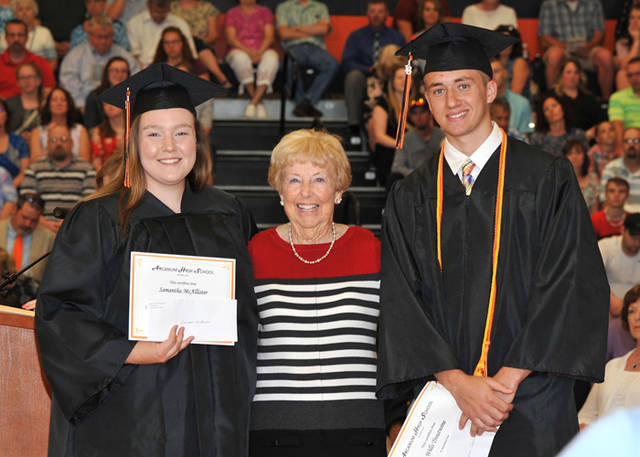 Marilyn Graeff (center) of Arcanum awards scholarships to Arcanum graduates Samantha McAllister (left) and Wills Troutwine. Awards are from the Richard Graeff Family Scholarship Fund of the Darke County Foundation.
