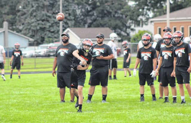 Arcanum's quarterback throws a pass during the Trojans' final 7-on-7 practice with Fort Recovery last Thursday at Arcanum. Monday is the first official day of practice for high school football teams in Ohio. The first two days are helmets only followed by two days of helmets and shoulder pads and then teams can begin full contact. The first scrimmage games for Darke County teams will be held Aug. 7 and the regular season for all Darke County teams kicks off on Friday, Aug. 24.